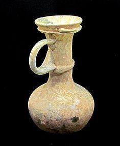 A ROMAN GREEN GLASS JUGLET