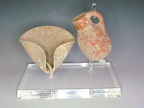 AN IRON AGE DIPPER JUGLET AND OIL LAMP SET