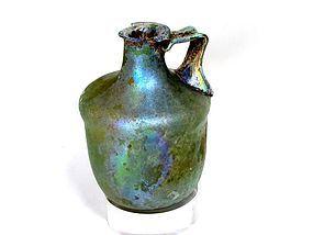 A HERODIAN GLASS CYLINDRICAL JUG