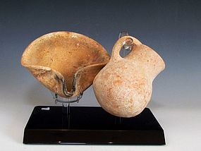 AN ISRAELITE CLAY OIL LAMP AND JUGLET SET