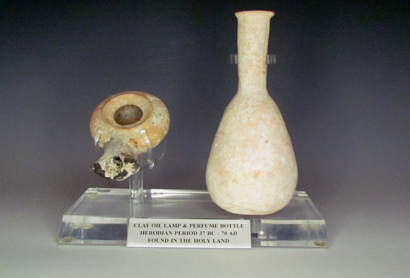 A HERODIAN TERRACOTTA OIL LAMP AND ALBASTRON FROM THE TIME OF CHRIST