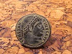 A ROMAN BRONZE FOLLIS OF CONSTANTINE I WITH OLIVE WOOD BOX