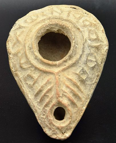 A BYZANTINE TERRACOTTA SLIPPER LAMP WITH INSCRIPTION