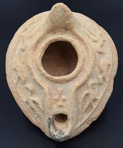 AN UMAYYAD TERRACOTTA OIL LAMP WITH ANIMAL MOTIF