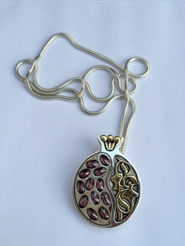 A HANDMADE SILVER POMEGRANATE PENDANT WITH GARNETS AND GOLD ON SILVER