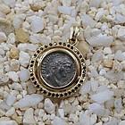 A ROMAN ARGENTEUS OF CONSTANTIUS I SET IN 18K PENDANT WITH DIAMONDS