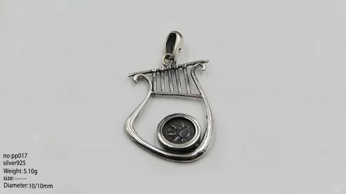 A WIDOWS MITE OF ALEXANDER JANNAEUS SET IN SILVER HARP PENDANT