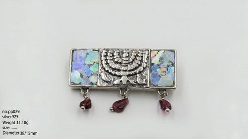 A ROMAN GLASS FRAGMENT IN SILVER BROOCH WITH MENORAH