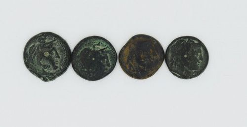 FOUR PTOLEMAIC BRONZE COINS BEARING THE IMAGE OF ALEXANDER THE GREAT