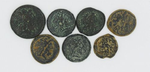 SEVEN BRONZE COINS OF  PTOLEMY III-IV FROM THE TYRE MINT