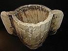 A JEWISH LIMESTONE MEASURING CUP