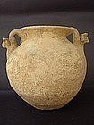 A SYRO-HITTITE TERRACOTTA AMPHORA WITH APPLIED HEADS