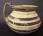 A DAUNIAN WARE SINGLE HANDLED JUGLET
