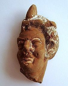 A HELLENISTIC TERRACOTTA HEAD OF A WOMAN OR A GODDESS