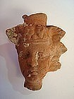 A HELLENISTIC EGYPTIAN TERRACOTTA HEAD OF DIONYSOS