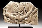 A LARGE ROMAN MARBLE SARCOPHAGUS FRAGMENT