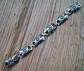 "floral link sterling bracelet by the famous ""EB""  Co."