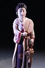 JAPANESE IVORY OKIMONO: STANDING BEAUTY,