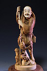FINE JAPANESE CARVED IVORY FIGURE OF A FISHERMAN