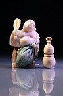 Two Japanese Carved Ivory Netsuke,