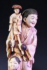 FINE POLYCHROMED IVORY OKIMONO FIGURE, Puppeteer,