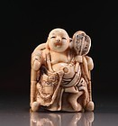 Japanese Carved Ivory Netsuke, Sitting Buddha.