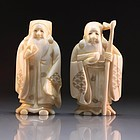 Pair of Japanese Carved Ivory Netsuke/Size Figures.