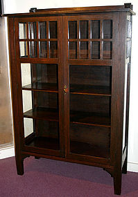 Arts and Crafts oak china cabinet, c.1910