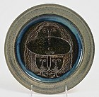 Scheier art pottery plate with three faces