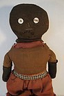 Early black stockinette doll with button eyes