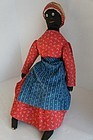 Early black cloth doll with red calico dress 1890
