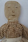 Early cloth doll with embroidered face brown calico dress