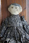 Ink face brown eyed antique cloth doll black/ brown calico dress