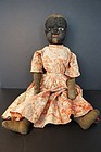 "Beecher type black cloth doll sculptured face 20"" antique 1890"