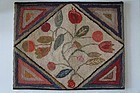 Great size, color design antique tulip hooked rug 29 by 36