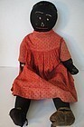 Big heavy antique black cloth doll soulful face red calico dress