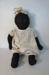 Black cloth antique baby doll unusual to find early nice