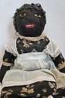 All original antique black cloth doll with great clothes