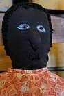 Big black doll with an amazing face and nice old dress antique