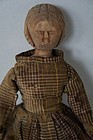 Unusual hand carved wooden shoulder head doll with cloth body