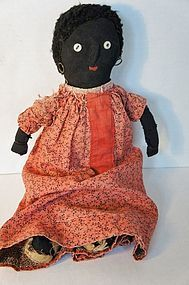 Old black cloth doll with red calico dress antique stockinette