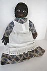 An important painted face black cloth doll with provenance 1888
