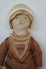 Embroidered face, great eyes and pouty mouth antique cloth doll