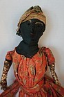 A black cloth doll in original clothes sweet face 1880