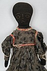 Pensive antique black stockinette cloth doll stitched face