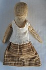 Early cloth doll with pencil face antique brown ticking skirt