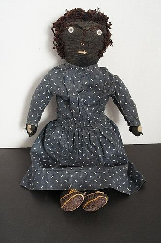 Antique black cloth rag doll with embroidered face