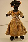 Happy little black cloth doll with original clothes antique