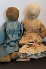 Friends, two antique cloth dolls one black one white by the same maker