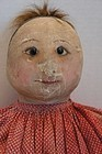 Antique painted face cloth doll with a top knot you won't believe